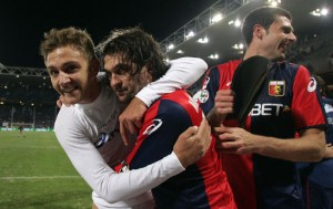 Genoa's defender Domenico Criscito, Omar Milanetto and Thiago Motta, from left, celebrate at the end of the Italian Serie A major league soccer match between Genoa and Sampdoria, at the Ferraris stadium in Genoa, Italy, Sunday, Dec. 7, 2008. Genoa won 1-0. (AP Photo/Carlo Baroncini)