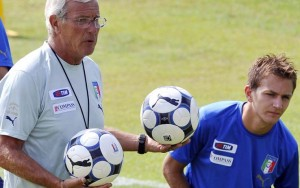 Italian national soccer team coach Marcello Lippi, left, speaks to player Domenico Criscito, during a practice session at the Coverciano training grounds, near Florence, central Italy, Tuesday Aug. 11, 2009. Italy is scheduled to play a friendly match against Switzerland in Basel, Wednesday Aug. 12, 2009, its first match since its disastrous showing at the Confed Cup in South Africa in June. (AP Photo/Lorenzo Galassi)
