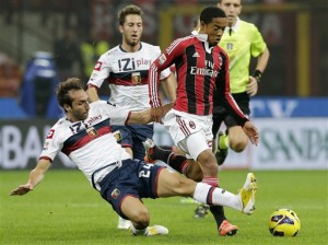 AC Milan midfielder Urby Emanuelson, right, of the Netherlands, is tackled by Genoa defender Emiliano Moretti during the Serie A soccer match between AC Milan and Genoa at the San Siro stadium in Milan, Italy, Saturday, Oct. 27, 2012. (AP Photo/Antonio Calanni)