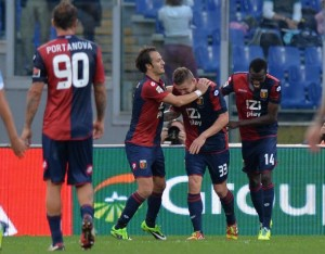 Genoa's Juraj Kucka celebrates with his teammates after scoring the 0-1 during the Serie A soccer match between SS Lazio and Genoa at the Olimpico stadium in Rome, Italy, 03 November 2013.  ANSA/ETTORE FERRARI